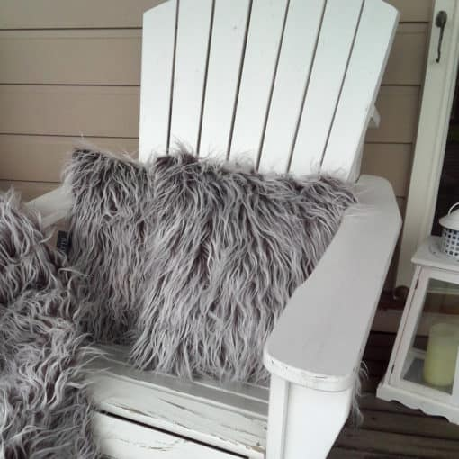 Shaggy brown fur on outdoor seat