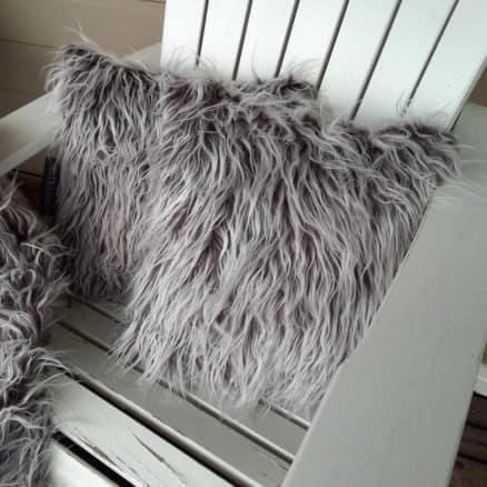 brown shaggy cushion on chair