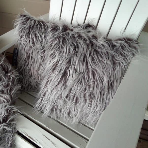 brown shaggy cushion on chair