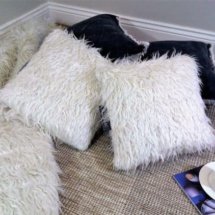White shaggy cushion