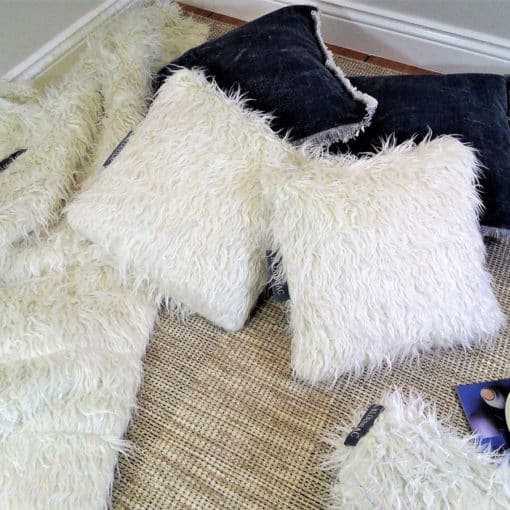White faux fur pillows