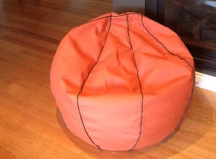 Bean bag in front of fireplace